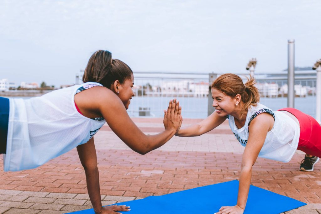 two women working out without anti-obesity drugs